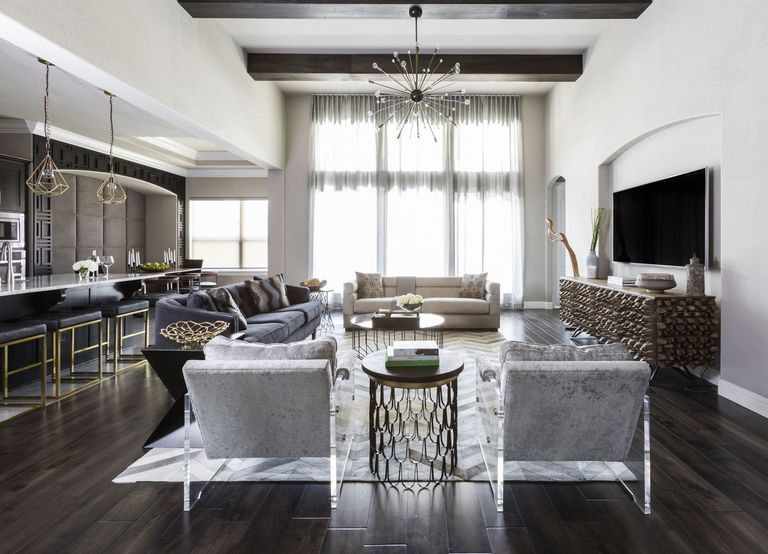 gallery-1471984081-black-walls-living-room-chairs